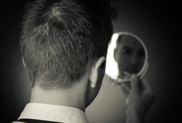 bigstock-looking-in-the-mirror-and-refl-52597648-583x393